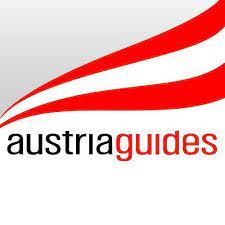Logo mit Austria Guides, hinten weht eine österreichische Fahne